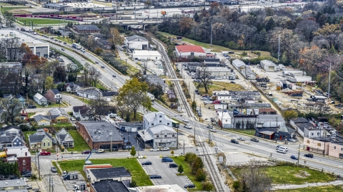 DXP001_099_0010 - Aerial stock photo of A busy street and railroad tracks in industrial area in Lexington, Kentucky
