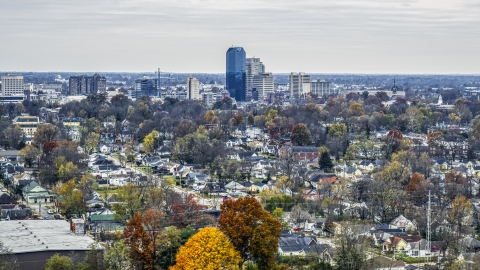 DXP001_099_0012 - Aerial stock photo of The city skyline while flying by tree-lined neighborhoods, Downtown Lexington, Kentucky