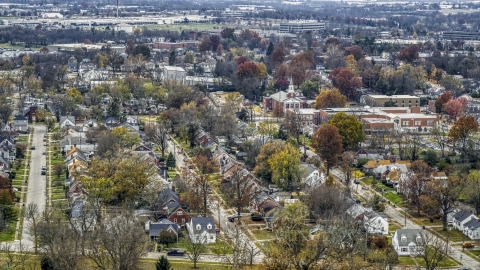 DXP001_099_0015 - Aerial stock photo of A church steeple and a tree-lined suburban neighborhood in Lexington, Kentucky