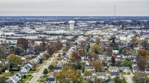 DXP001_099_0017 - Aerial stock photo of Homes with view of a water tower surrounded by warehouses in Lexington, Kentucky