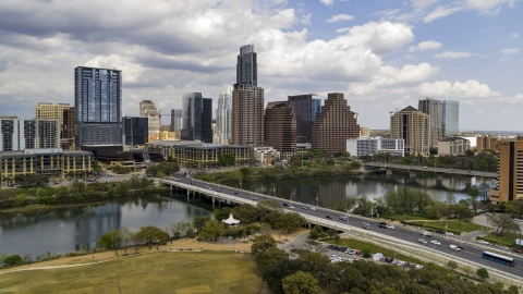 DXP002_102_0002 - Aerial stock photo of The First Street Bridge and Lady Bird Lake with view of skyline, Downtown Austin, Texas