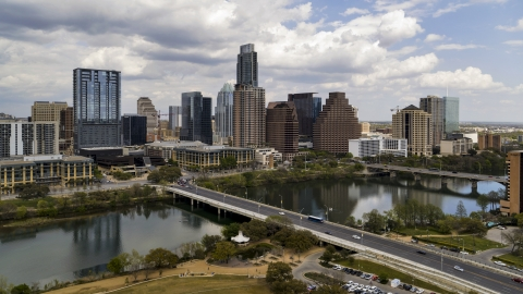 DXP002_102_0004 - Aerial stock photo of The First Street Bridge, Lady Bird Lake and skyline of Downtown Austin, Texas