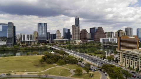 DXP002_102_0006 - Aerial stock photo of The city's skyline seen from First Street Bridge and Lady Bird Lake, Downtown Austin, Texas