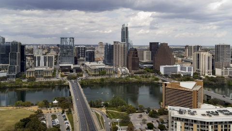 DXP002_102_0008 - Aerial stock photo of The First Street Bridge spanning Lady Bird Lake, looking toward the skyline, Downtown Austin, Texas