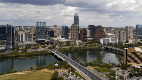 DXP002_102_0009 - Aerial stock photo of The city skyline seen from across Lady Bird Lake, Downtown Austin, Texas