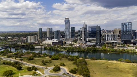 DXP002_102_0012 - Aerial stock photo of City skyscrapers across Lady Bird Lake, Downtown Austin, Texas