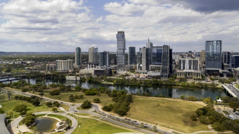 DXP002_102_0013 - Aerial stock photo of Skyscrapers across Lady Bird Lake, Downtown Austin, Texas