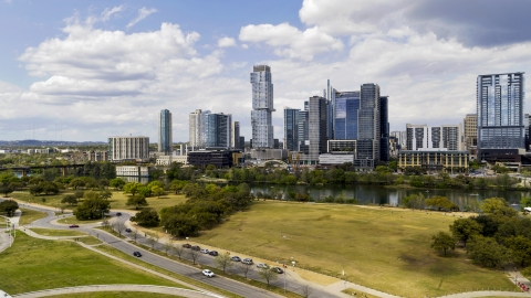 DXP002_102_0015 - Aerial stock photo of A view of city skyline across Lady Bird Lake in Downtown Austin, Texas