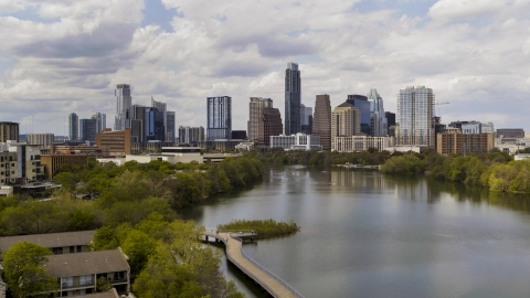 DXP002_102_0016 - Aerial stock photo of A view of the city skyline from the shore of Lady Bird Lake, Downtown Austin, Texas