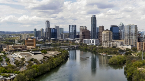 DXP002_102_0018 - Aerial stock photo of Skyscrapers in the city skyline seen from Lady Bird Lake, Downtown Austin, Texas
