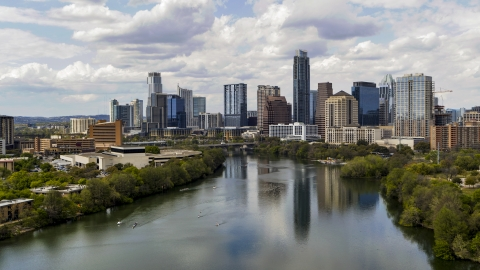 DXP002_102_0019 - Aerial stock photo of A view of the city skyline and Lady Bird Lake in Downtown Austin, Texas