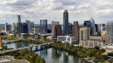 DXP002_102_0020 - Aerial stock photo of The city skyline beside bridges and Lady Bird Lake, Downtown Austin, Texas