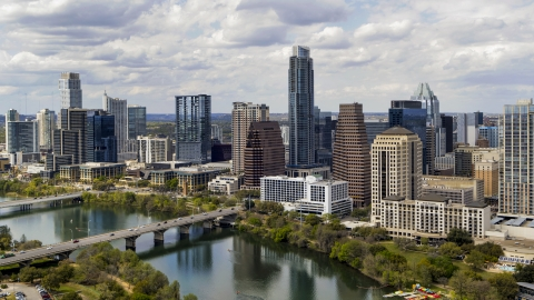 DXP002_102_0021 - Aerial stock photo of Tall skyscrapers in the city skyline by bridges and Lady Bird Lake, Downtown Austin, Texas