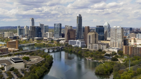 DXP002_102_0022 - Aerial stock photo of The city skyline by Lady Bird Lake, Downtown Austin, Texas