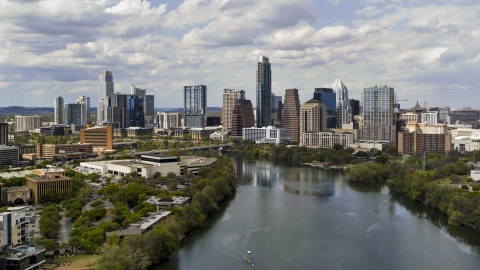 DXP002_102_0023 - Aerial stock photo of A view of the city skyline while flying over Lady Bird Lake, Downtown Austin, Texas
