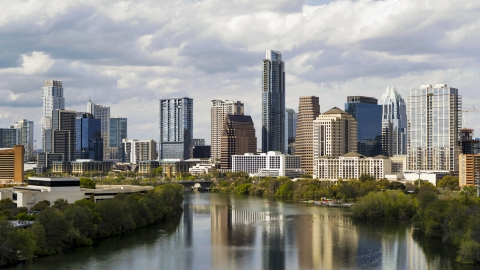 DXP002_103_0001 - Aerial stock photo of Lady Bird Lake and skyscrapers in Downtown Austin, Texas