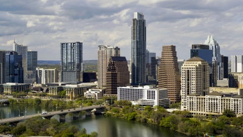 DXP002_103_0002 - Aerial stock photo of The Austonian and skyscrapers by Lady Bird Lake in Downtown Austin, Texas