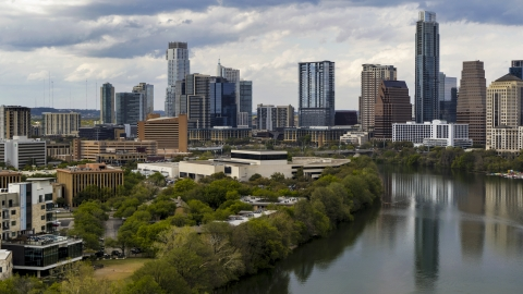 DXP002_103_0009 - Aerial stock photo of A view of waterfront skyscrapers by Lady Bird Lake in Downtown Austin, Texas