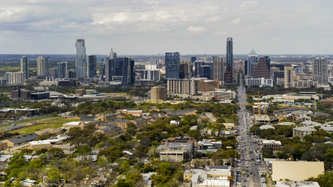DXP002_103_0011 - Aerial stock photo of A wide view of the city's skyline from Congress Avenue in Downtown Austin, Texas