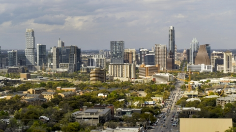 DXP002_103_0012 - Aerial stock photo of Congress Avenue and a view of the city's skyline in Downtown Austin, Texas