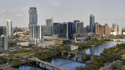 DXP002_104_0002 - Aerial stock photo of Towering city skyscrapers, and bridges spanning Lady Bird Lake, Downtown Austin, Texas