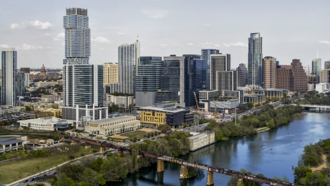 DXP002_104_0003 - Aerial stock photo of Tall skyscrapers and a bridge spanning Lady Bird Lake, Downtown Austin, Texas