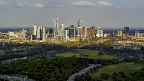 DXP002_104_0008 - Aerial stock photo of A wide view of city's towering skyline and the shore of Lady Bird Lake, Downtown Austin, Texas