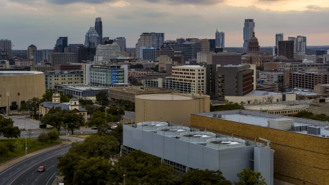 DXP002_105_0009 - Aerial stock photo of A view of hospital, skyscrapers and capitol dome at sunset in Downtown Austin, Texas