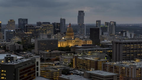 DXP002_105_0020 - Aerial stock photo of A view of office buildings, capitol and skyscrapers at twilight in Downtown Austin, Texas