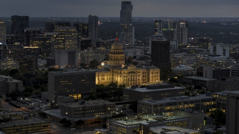 DXP002_105_0022 - Aerial stock photo of The Texas State Capitol at twilight in Downtown Austin, Texas