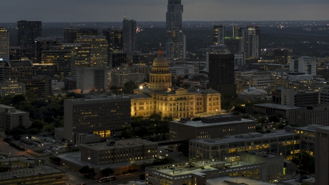 DXP002_105_0023 - Aerial stock photo of The state capitol building at twilight in Downtown Austin, Texas