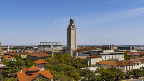 DXP002_107_0005 - Aerial stock photo of UT Tower at the University of Texas during ascent, Austin, Texas