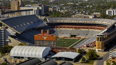 DXP002_108_0005 - Aerial stock photo of A view of the empty football stadium at the University of Texas, Austin, Texas
