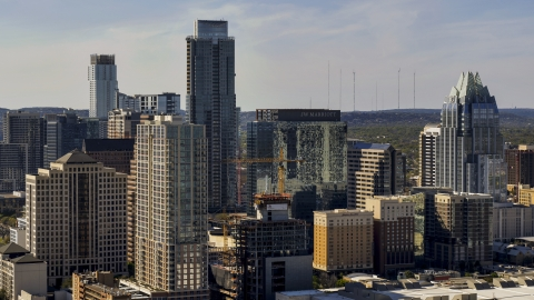 DXP002_108_0008 - Aerial stock photo of City skyscrapers around The Austonian in Downtown Austin, Texas