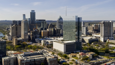 DXP002_108_0016 - Aerial stock photo of A hotel and the city's skyline in Downtown Austin, Texas