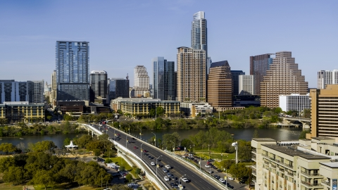DXP002_109_0001 - Aerial stock photo of The city's skyline across Lady Bird Lake seen from bridge, Downtown Austin, Texas