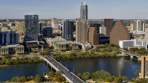 DXP002_109_0006 - Aerial stock photo of Skyscrapers in the city's skyline across Lady Bird Lake seen from a bridge in Downtown Austin, Texas