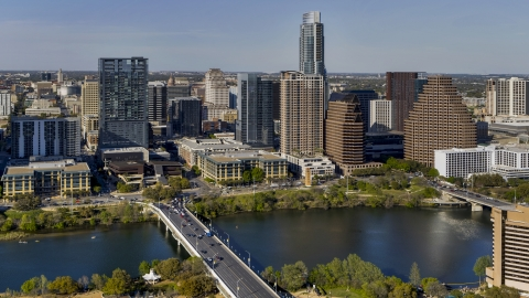 DXP002_109_0007 - Aerial stock photo of A view of skyscrapers of the city's skyline across Lady Bird Lake seen from a bridge, Downtown Austin, Texas