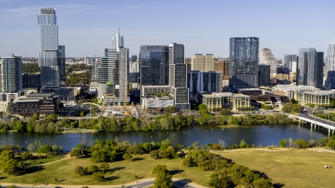 DXP002_109_0011 - Aerial stock photo of The Northshore skyscraper on the other side of Lady Bird Lake, Downtown Austin, Texas