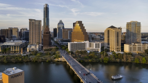 DXP002_110_0003 - Aerial stock photo of Waterfront skyscrapers across Lady Bird Lake at sunset in Downtown Austin, Texas