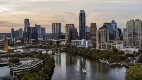 DXP002_110_0005 - Aerial stock photo of A view of Lady Bird Lake and the skyline at sunset in Downtown Austin, Texas