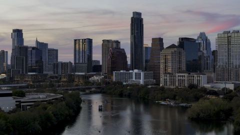 DXP002_110_0013 - Aerial stock photo of The skyline by Lady Bird Lake at twilight in Downtown Austin, Texas