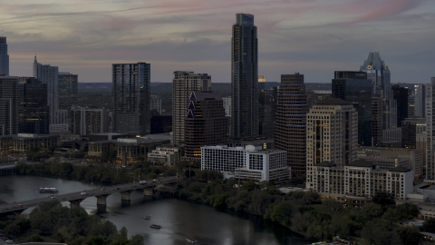 DXP002_110_0014 - Aerial stock photo of Bridge and skyscrapers by Lady Bird Lake at twilight in Downtown Austin, Texas