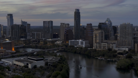 DXP002_110_0015 - Aerial stock photo of The skyline by Lady Bird Lake and bridge at twilight in Downtown Austin, Texas