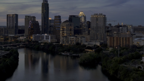 DXP002_110_0019 - Aerial stock photo of San Jacinto Center beside Lady Bird Lake at twilight in Downtown Austin, Texas