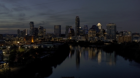 DXP002_111_0001 - Aerial stock photo of A view of Lady Bird Lake, focus on the waterfront skyline at twilight in Downtown Austin, Texas