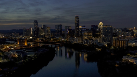 DXP002_111_0002 - Aerial stock photo of A view of Lady Bird Lake, focus on the waterfront skyline at twilight in Downtown Austin, Texas