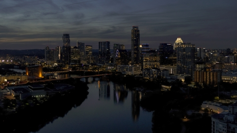 DXP002_111_0003 - Aerial stock photo of The waterfront skyline on the shore of Lady Bird Lake at twilight in Downtown Austin, Texas