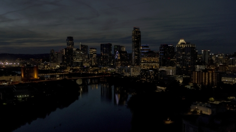 DXP002_111_0004 - Aerial stock photo of A waterfront skyline on the shore of Lady Bird Lake at twilight in Downtown Austin, Texas