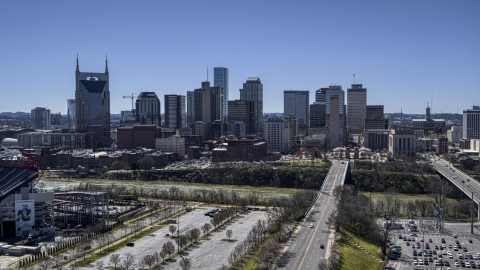 DXP002_112_0001 - Aerial stock photo of The city's skyline near the river in Downtown Nashville, Tennessee